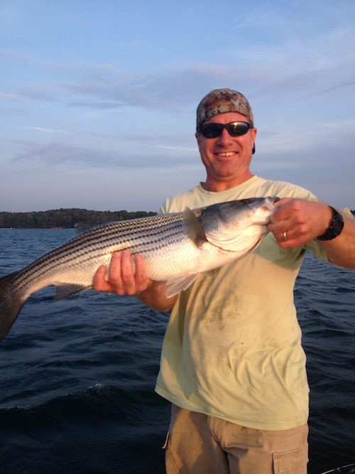 On fire call in sick uponlanier lake for Lake lanier striper fishing
